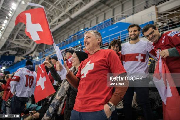 Swiss hockey fans celebrate after Switzerland's win against Sweden in their Women's Ice Hockey Preliminary Round Group B game at Kwandong Hockey...