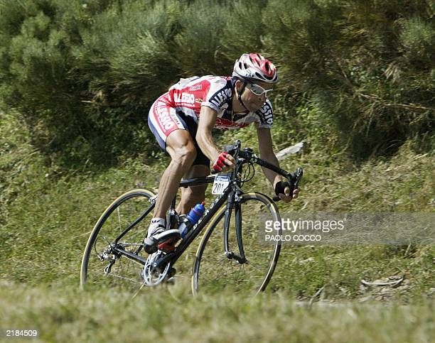 Swiss Laurent Dufaux rides during the 13th stage of the 90th Tour de France cycling race between Toulouse and Ax3 Domaines 19 July 2003 AFP PHOTO...