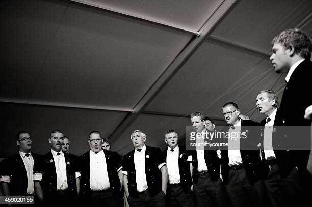 swiss male choir yodeling - choir stock photos and pictures