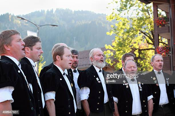 swiss male yodel choir show facial expressions at agricultural festival - swiss culture stock pictures, royalty-free photos & images