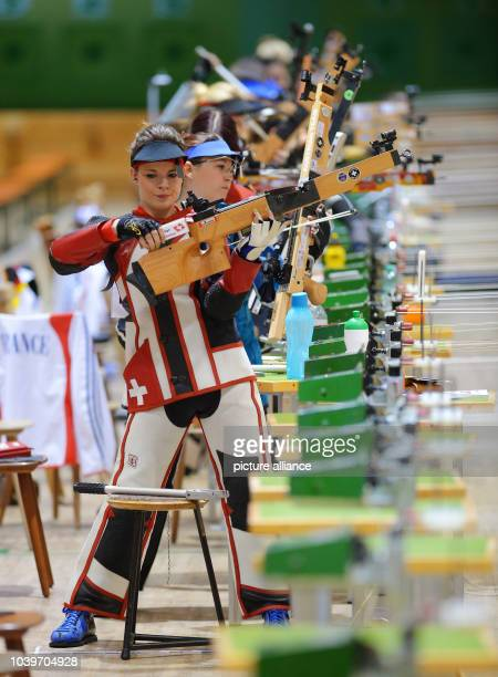 Swiss Mara Schoenholzer cocks her weapon during the 10 meters crossbow shooting at the 17th crossbow World Cup in Frankfurt/Main, Germany, 08 August...