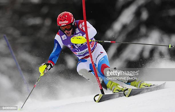 Swiss Marc Gini clears a gate on his way to clock the 7th time during the first run of the men's World Cup Slalom race in Val Badia on December 21,...