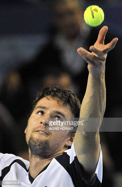 """Swiss Marco Chiudinelli serves to French Michael Llodra on February 22 in the southern city of Marseille, during the """"Open 13"""" tournament. AFP PHOTO..."""