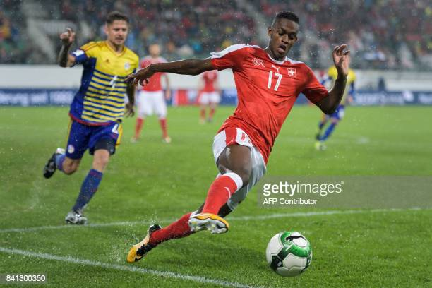 Swiss midfielder Edimilson Fernandes runs with the ball during the FIFA WC 2018 qualification football match between Switzerland and Andorra at the...
