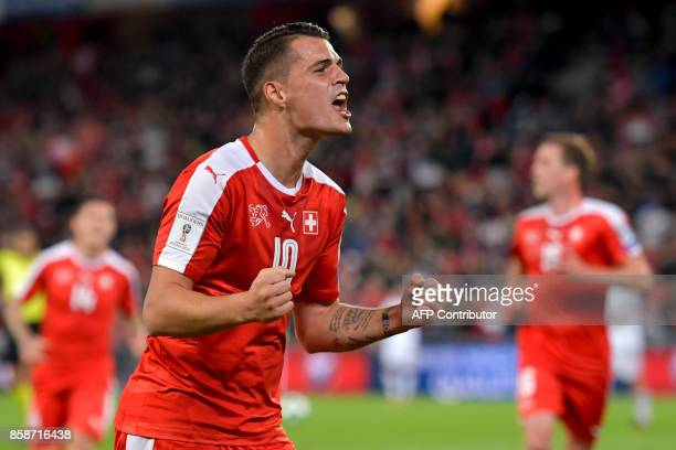 Swiss midfielder Granit Xhaka celebrates a goal during the FIFA World Cup 2018 football qualifier match between Switzerland and Hungary at the St....