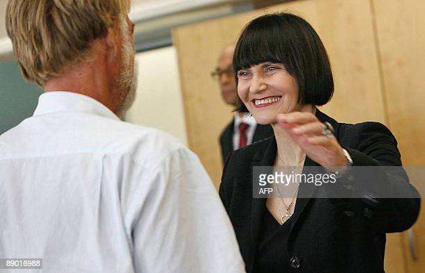 Swiss Minister of Foreign Affairs Micheline Calmy-Rey welcomes freed Swiss hostage Werner Greiner upon his arrival on July 14, 2009 at Zurich...
