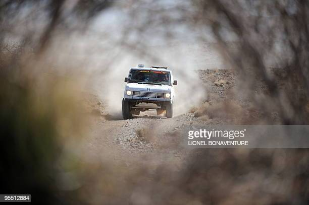 Swiss Miroslav Kubicek drives his Range Rover during the second stage of the second edition of the Africa Eco Race on December 31 2009 The Africa...