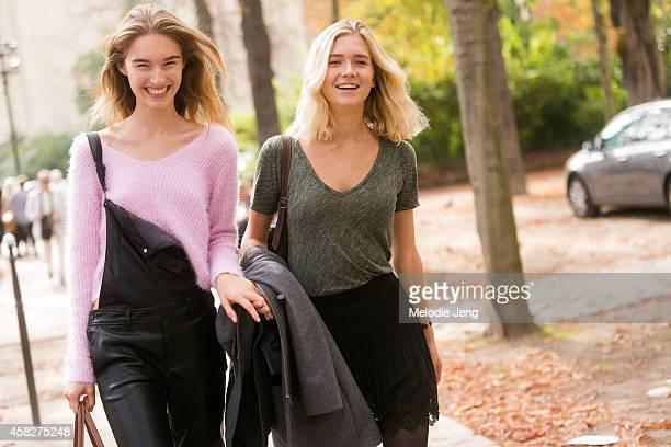 Swiss model Manuela Frey and Nora Escher exit the Giambattista Valli show at Grand Palais on Day 7 of Paris Fashion Week Spring/Summer 2015 on...