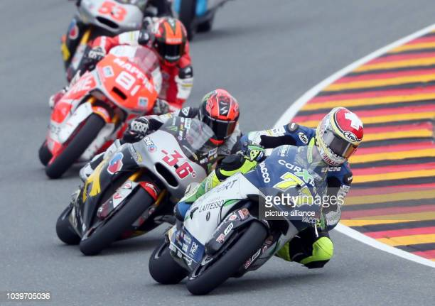 Swiss Moto2 driver Dominique Aegerter from the Technomag carXpert Team Finnish Mika Kallio from the Marc VDS Racing Team and Spanish Jordi Torres...