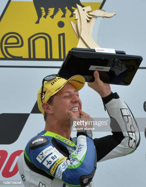 Swiss Moto2 driver Dominique Aegerter from the Technomag carXpert Team cheers after his victory during the German Motorcycling Grand Prix at...