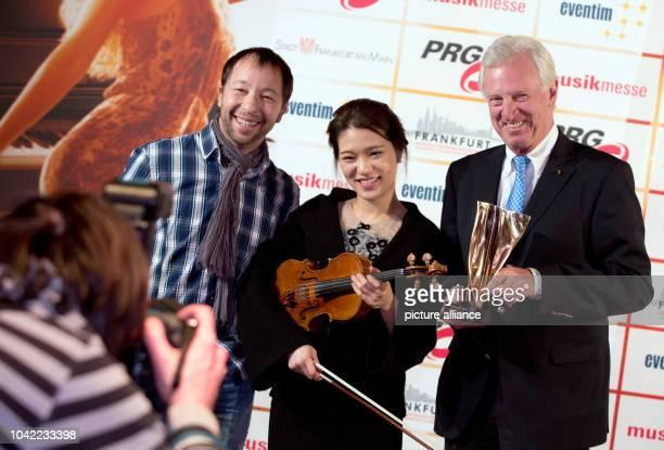 Swiss musician and producer PeterRene Baumann aka DJBobo violinist YeEun Choi and Michael Russ concert organizer and deputy chairman of the...