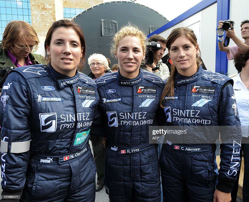 Swiss Natacha Gaghnang, Rahel Frey, and their compatriot Cyndie Allemann, drivers of a Ford GT, pose on June 6, 2010 in Le Mans, western France. Fifty-six cars with 168 drivers will participate on June 12 and 13 in the 78th edition of the Le 24-hour endurance race.