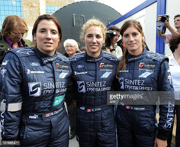 Swiss Natacha Gaghnang Rahel Frey and their compatriot Cyndie Allemann drivers of a Ford GT pose on June 6 2010 in Le Mans western France Fiftysix...