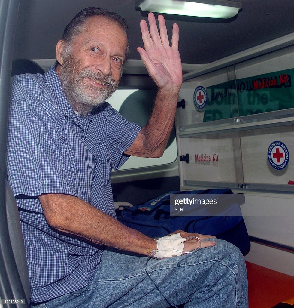 Swiss national Carl Rieth, 72, waves to photographers aboard an ambulance hours after he was rescued by troops and police from Islamist Abu Sayyaf militants June 16, 2010. Rieth, a businessman who is a long-time resident of the southern city of Zamboanga, was kidnapped by suspected Abu Sayyaf militants on April 4.
