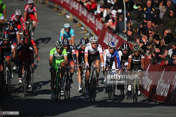 Swiss National Champion Michael Schar leads the peloton over the finish line during the 2014 Strade Bianchi from to San Gimignano to Siena ll Campo...