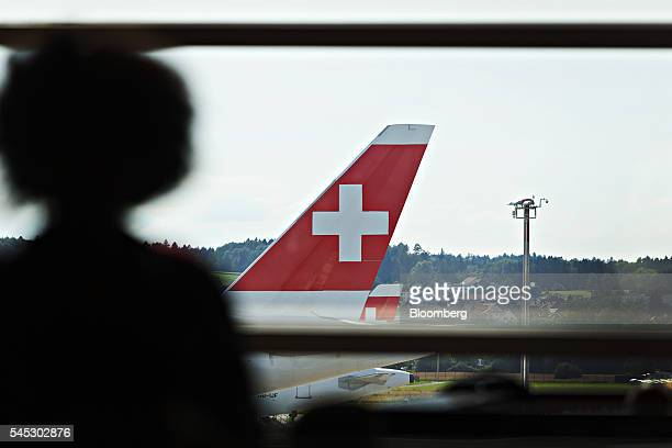 A Swiss national flag sits on the tailfin of a passenger aircraft operated by Swiss International Air Lines AG at Zurich Airport operated by...