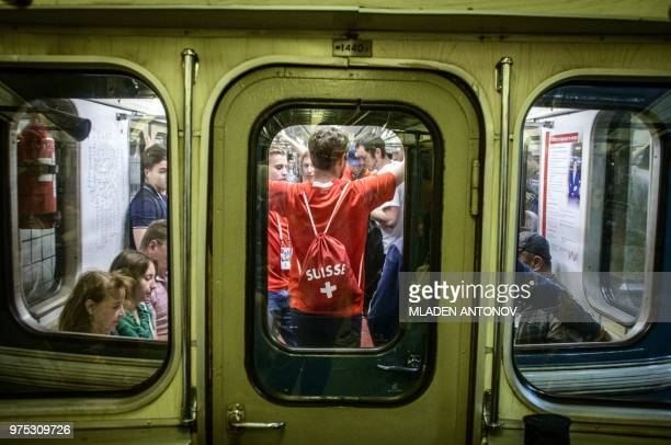 TOPSHOT Swiss national football team's fans take the metro in Moscow on June 15 2018