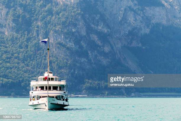 swiss passenger craft on lake lucerne in fluelen, switzerland - schwyz stock pictures, royalty-free photos & images