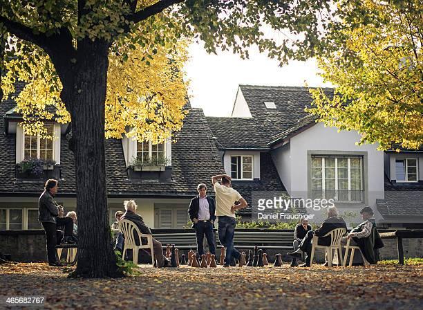 Swiss people playing chess on a autumn afternoon at Lindenhof in Zurich. In Zurich, Switzerland.