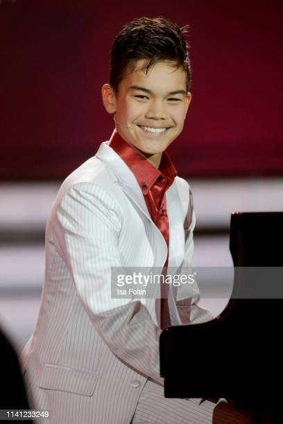 Swiss pianist Ricky Kam performs onstage during the television show 'Willkommen bei Carmen Nebel' at Velodrom on May 4, 2019 in Berlin, Germany.