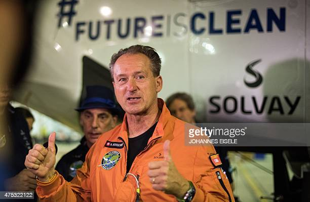 Swiss pilot Andre Borschberg gives the thumbsup as he talks to the press before the Swissmade solarpowered plane Solar Impluse 2 takes off from...