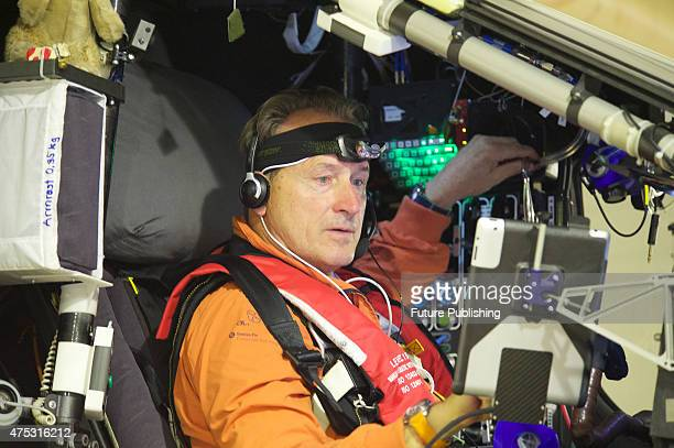 Swiss pilot Andre Borschberg prepares in the cockpit before his departure from Nanjing Airport on May 31 2015 in Nanjing China The sixday nonstop...