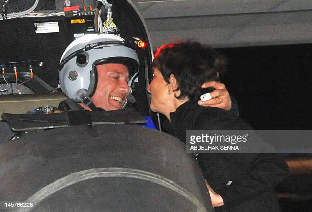 Swiss pilot Bertrand Piccard kisses his wife Michele after landing late on June 5 2012 the Solar Impulse solar plane at Rabat Sale airport The Swiss...