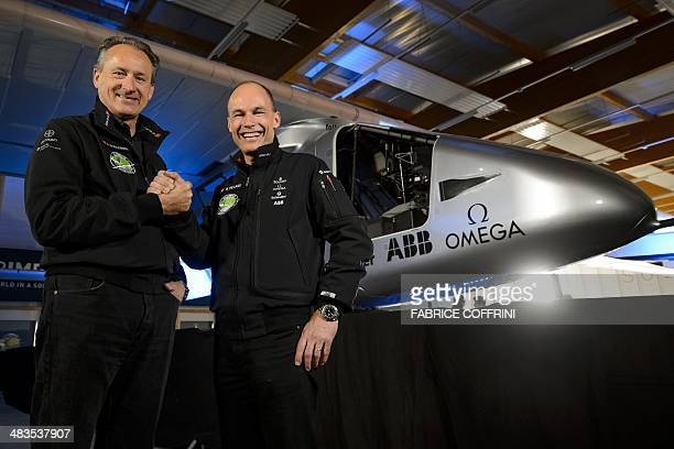 Swiss pilots Bertrand Piccard and Andre Borschberg who flew the Solar Impulse experimental solarpowered plane on a transcontinental trip pose on...