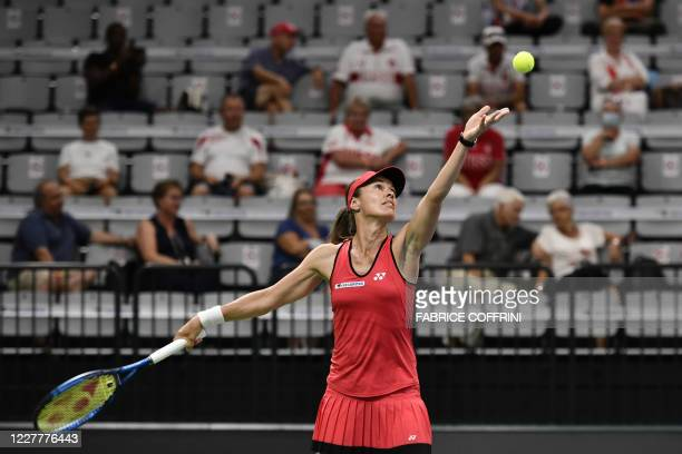 Swiss player Martina Hingis serves a ball during her match against compatriot Patty Schnyder at the Swiss Tennis Pro Cup exhibition tournament on...