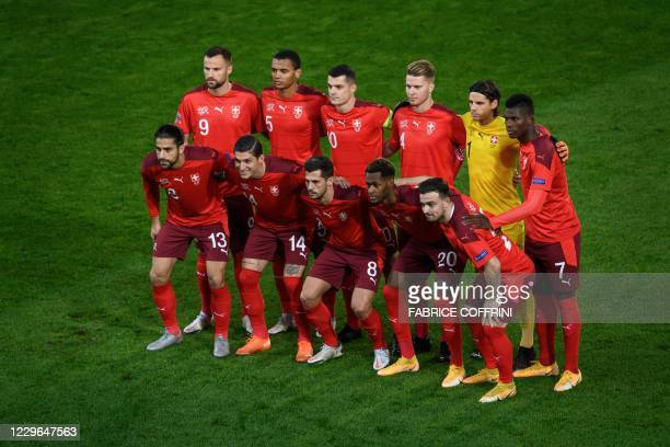 forward Haris Seferovic defender Manuel Akanji midfielder Granit Xhaka defender Nico Elvedi goalkeeper Yann Sommer and forward Breel Embolo Front raw...