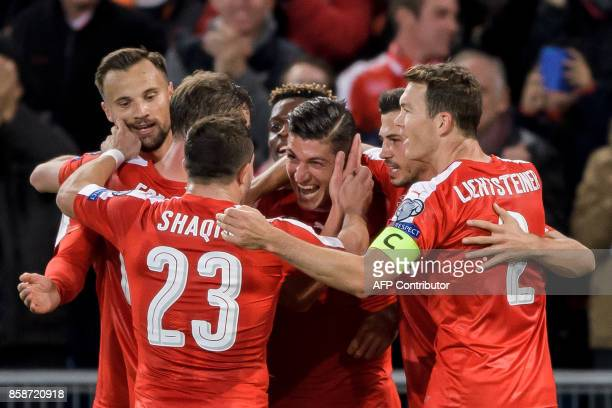 Swiss players celebrate a goal during the FIFA World Cup WC 2018 football qualifier match between Switzerland and Hungary at the St JakobPark Stadium...