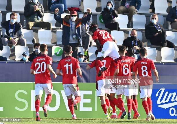 Swiss players celebrate after scoring a goal during the 2021 UEFA European Under-21 Championship Group D football match between England and...