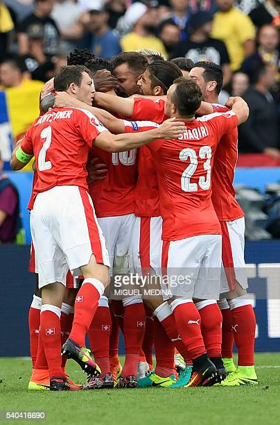 Swiss players celebrate the goal of Switzerland's forward Admir Mehmedi during the Euro 2016 group A football match between Romania and Switzerland...