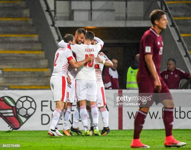 Swiss players celebrates after scoring during the FIFA World Cup 2018 qualification football match between Latvia and Switzerland in Riga on...