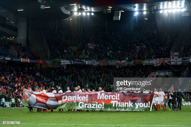 Swiss players celebrates their qualification at the end of the FIFA 2018 World Cup playoff second leg football match between Switzerland and Northern...