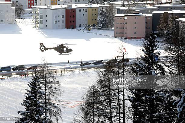 A Swiss police helicopter hovers above the helipad at the InterContinental Hotel Davos operated by InterContinental Hotels Group Plc ahead of the...