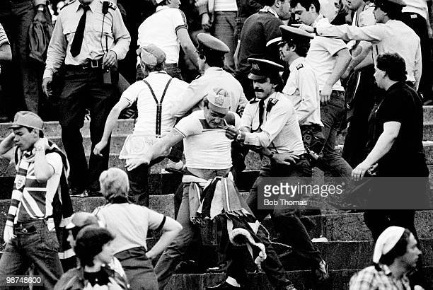 Swiss police move in to arrest some England football supporters after fighting on the terraces during halftime at the World Cup Qualifying match...