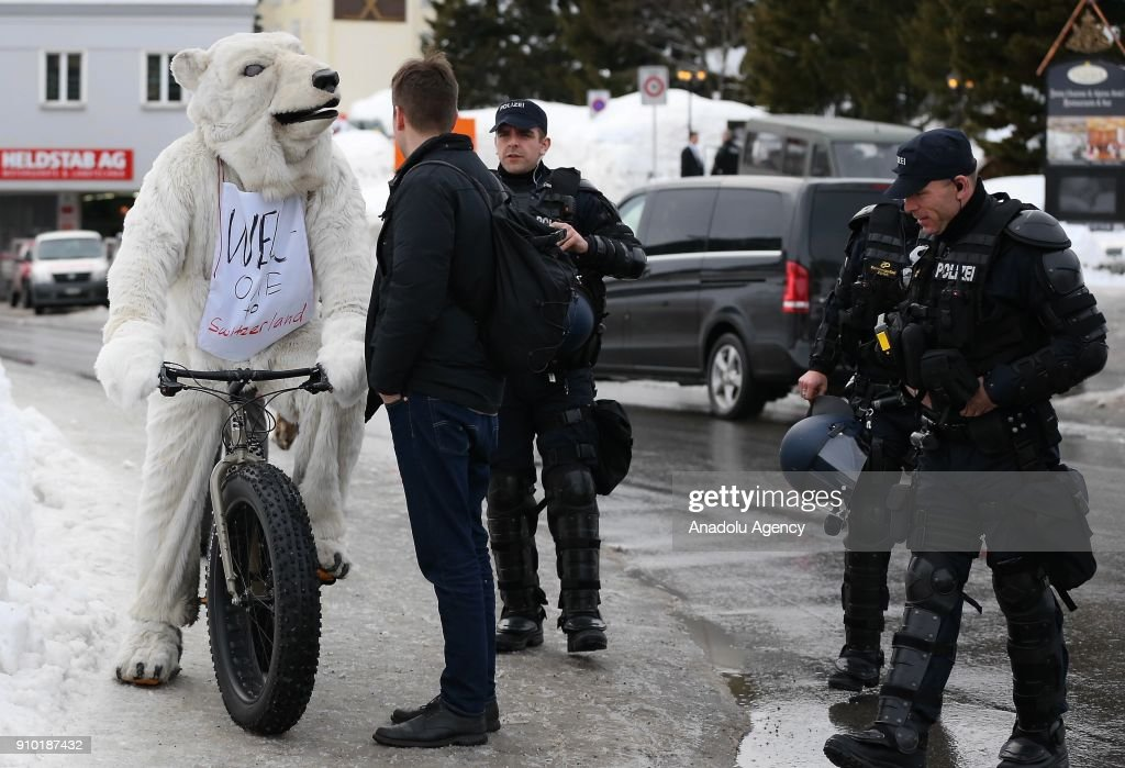 33c37b1cd533 Swiss police officers take security measures as a demonstrator with ...