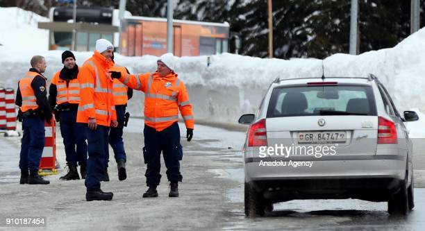 Swiss police officers take security measures as US President Donald J Trump is protested by a demonstrator during the 48th World Economic Forum in...