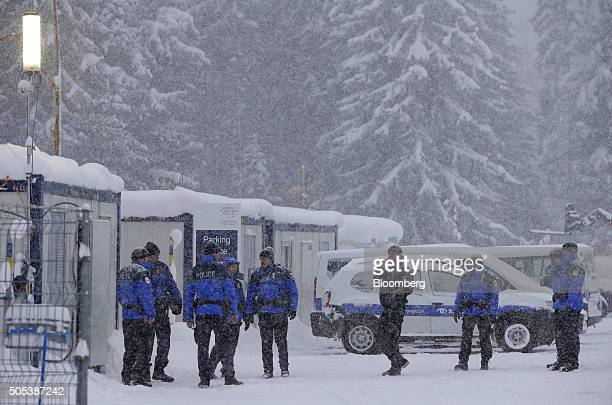 Swiss police stand talking in the car park at the conference centre in Davos Switzerland on Saturday Jan 16 2016 World leaders influential executives...
