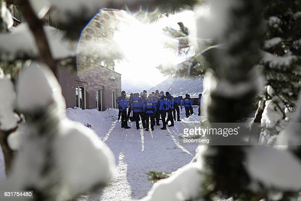Swiss police talk with each other during a security patrol ahead of the World Economic Forum in Davos Switzerland on Sunday Jan 15 2017 World leaders...