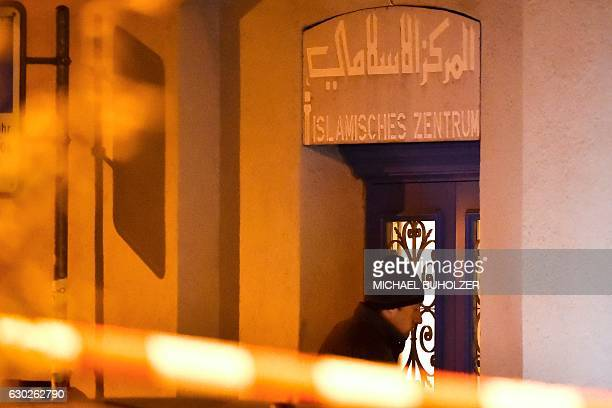 A Swiss policeman enters the Islamic Center in central Zurich on December 19 after three people were injured by gunfire in the Muslim prayer hall...