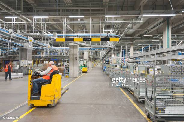 swiss postal service mail distribution center in zurich-muelligen - postal stock pictures, royalty-free photos & images