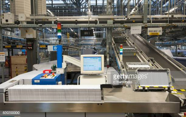 swiss postal service mail distribution center in zurich-mulligen - postal stock pictures, royalty-free photos & images