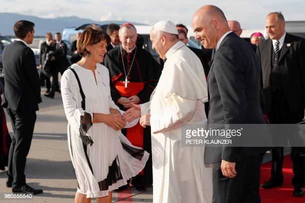 Swiss President Alain Berset and Swiss Federal Councillor Doris Leuthard escort back Pope Francis at the end of his visit to Geneva on June 21 2018...