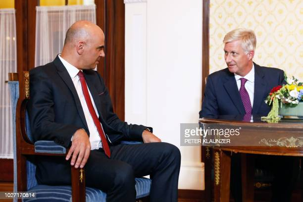 Swiss President Alain Berset speaks with King Philippe of Belgium prior to a meeting of the heads of six German speaking countries in Sils Maria...