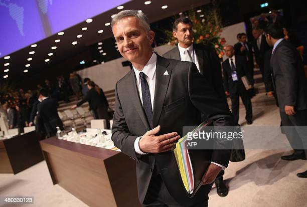 Swiss President Didier Burkhalter attends the opening session of the Nuclear Security Summit in The Hague on March 24 2014 AFP PHOTO/POOL/SEAN GALLUP