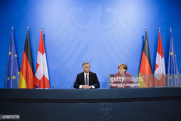 Swiss President Didier Burkhalter speaks with German Chancellor Angela Merkel to the media after talks at the Chancellery on February 18 2014 in...