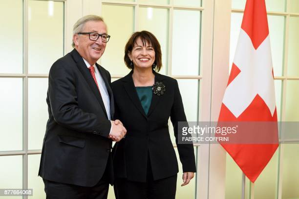 Swiss President Doris Leuthard shakes hands with European Commission President JeanClaude Juncker upon his arrival for an official visit on relation...