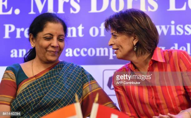 Swiss President Doris Leuthard talks with India Minister of State for Commerce and Industry Nirmala Sitharaman during the IndoSwiss Business and...